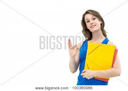 smiling woman with OK gesture and folder on white background