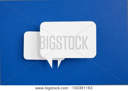paper speech bubble on blue background