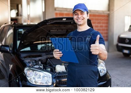 Smiling mechanic giving thumbs up