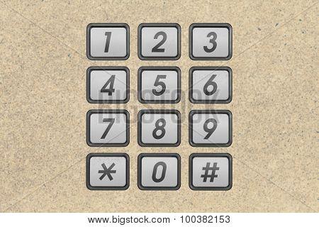 Metal phone number keypad on blurred background