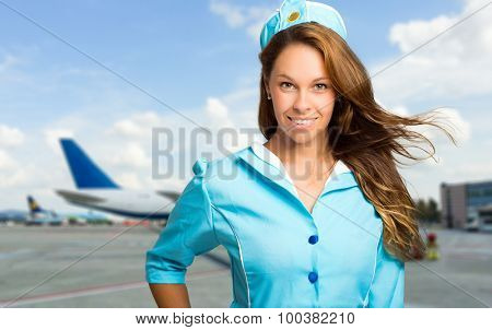 Beautiful hostess smiling at the airport