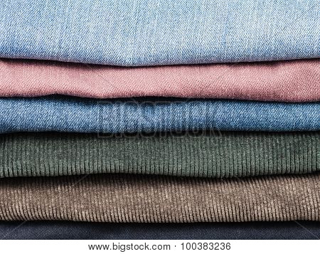 Stack Of Various Jeans And Corduroy Slacks