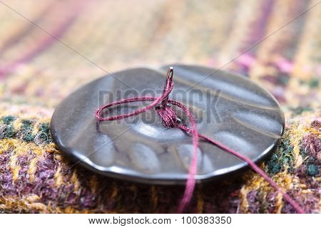 Attaching Of Button To Woolen Cloth By Needle