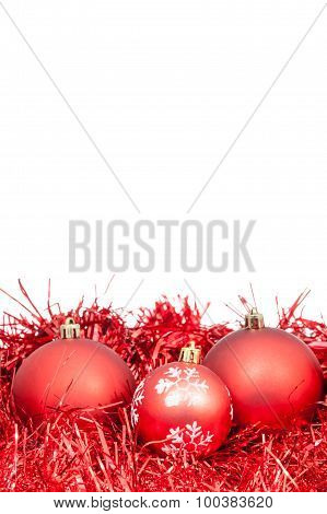 Three Red Christmas Balls And Tinsel Isolated