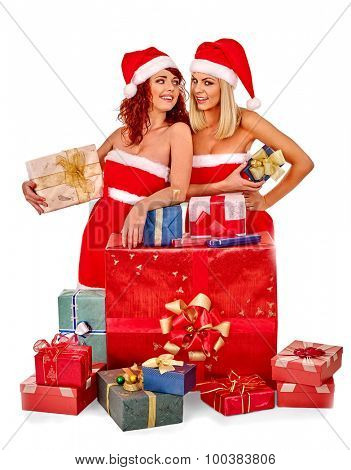 Women in Santa hat holding stack Christmas gift box.