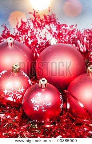 Xmas Red Baubles And Tinsel On Blue Background