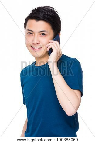 Asian young man talk to mobile phone