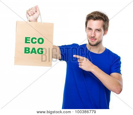 Man finger point to the shopping bag and showing phrase of eco bag