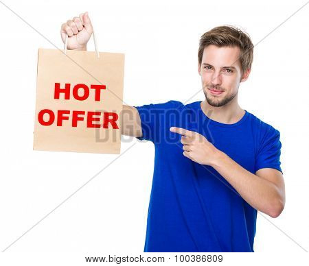 Man finger point to the shopping bag and showing phrase of hot offer