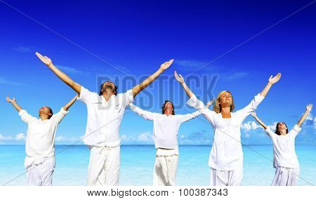 People performing yoga on the beach Concept