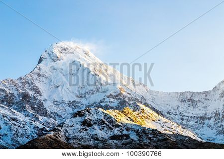 Sunrise Rays On The Snowcappped Peak Of Annapurna South