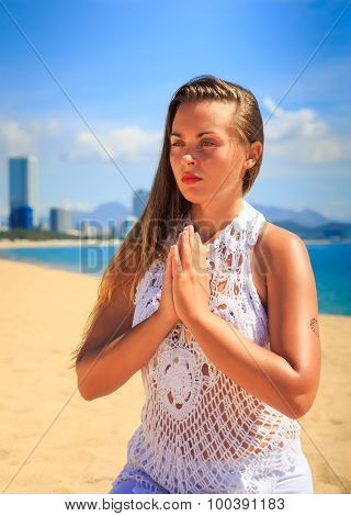 Blonde Girl In Lace Sits In Yoga Asana Thunderbolt On Beach