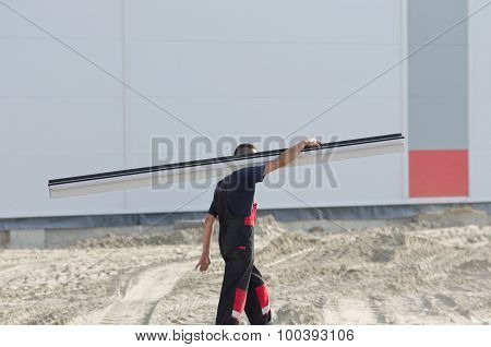 Worker Carrying Metal Profile