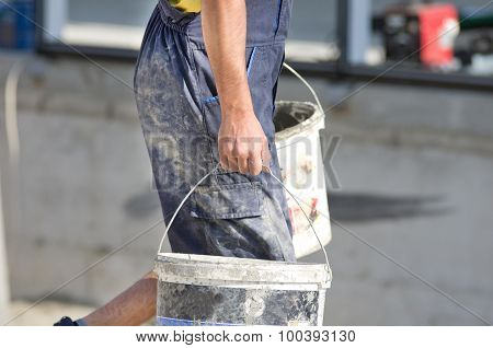 Worker With Buckets