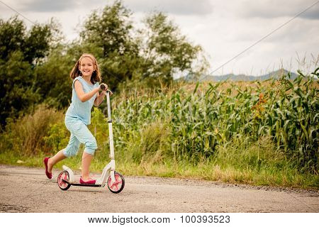 Child on scooter