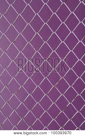 Wire Mesh, Iron Wire Fence On The Wall Purple Background.