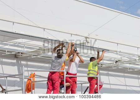 Workers Installing Awnings