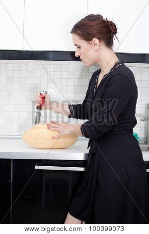 Woman Cuts Melon