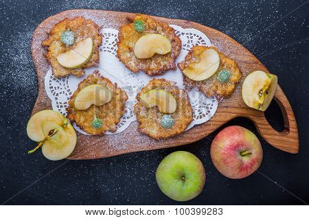 Pancakes With Apples Sprinkled With Icing Sugar