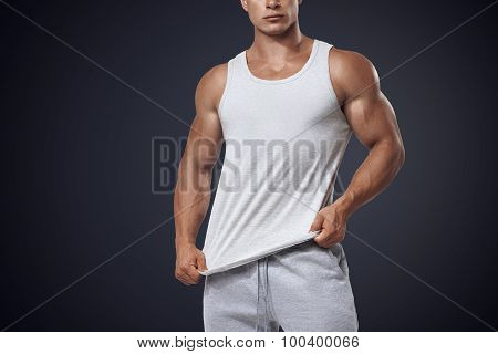Young Bodybuilder Wearing White Sleeveless T-shirt