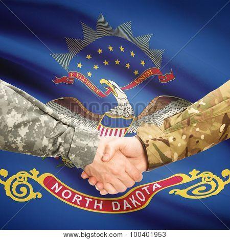 Military Handshake And Us State Flag - North Dakota