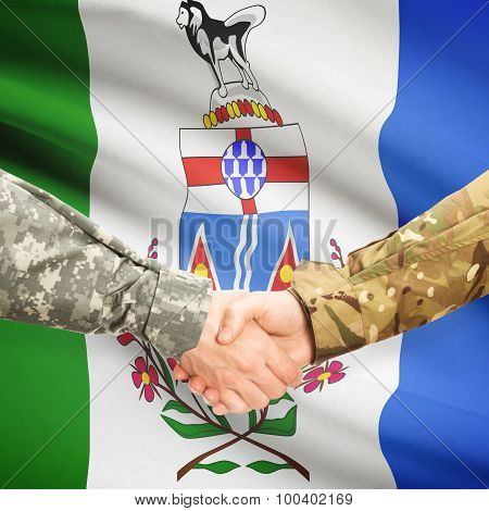 Military Handshake And Canadian Province Flag - Yukon
