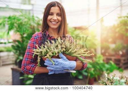 Attractive Nursery Owner In Her Greenhouse