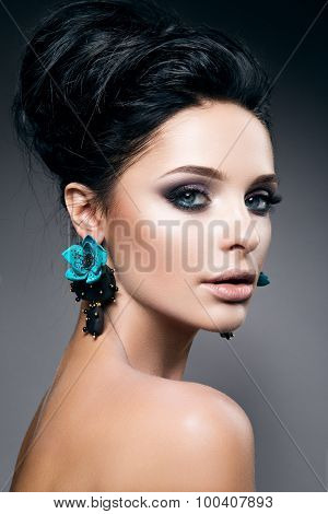 Portrait of beautiful young woman with black hair and bright make-up