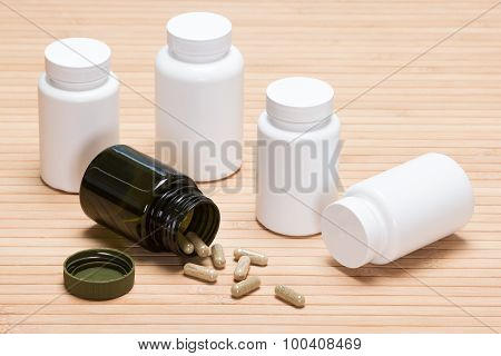 Scattered Capsules With Plastic Jars