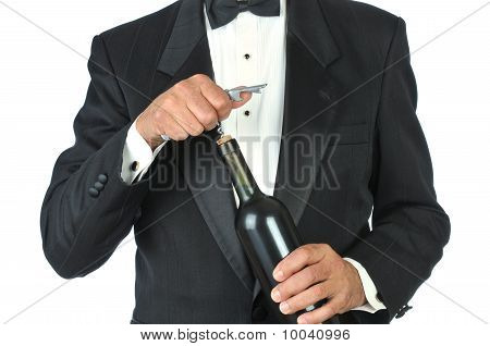 Waiter Opening Wine Bottle
