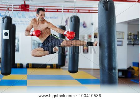 Kickbox Fighter Training With The Punch Bag