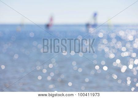 Defocused Seascape With Windsurfers On Sea Surface