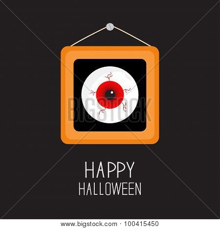 Picture Frame Hanging On The Wall Red Eyeball With Bloody Streaks. Happy Halloween Card. Balck Backg