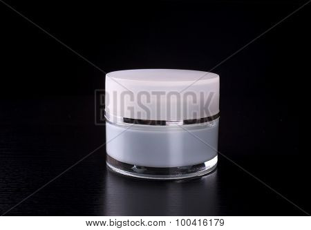 bottles cosmetic product on a black background