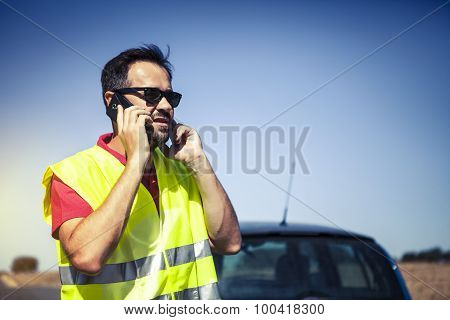 Man Calling To Insurance Company After A Car Breakdown.