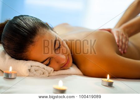 Attractive Young Woman Having Relaxing Massage In Spa.