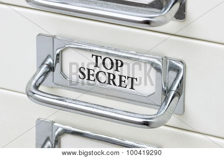 A Drawer Cabinet With The Label Top Secret