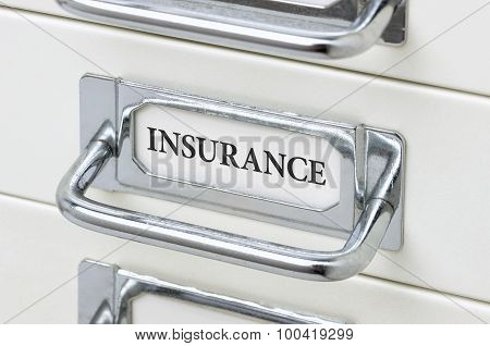 A Drawer Cabinet With The Label Insurance