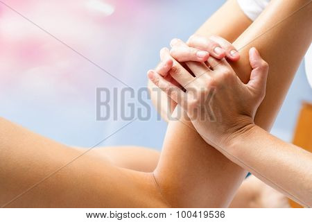 Female Hands Massaging Calf Muscle.