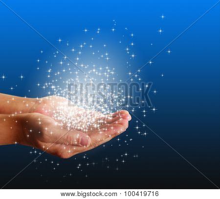 magic light and stars in hands