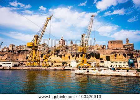 cranes and docks on the shore Cospicua near Valletta in Malta