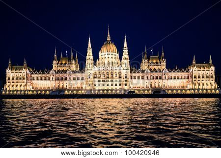 panoramic night view on the National Hungarian Parliament from the Danube river