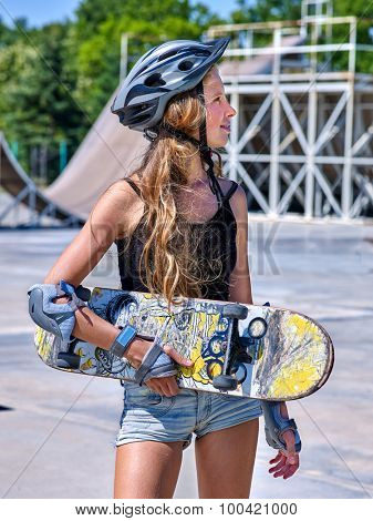 Teen in  shorts skateboarding  his skateboard outdoor. Skateboard girl style.