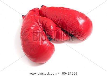 A set of red boxing gloves on white
