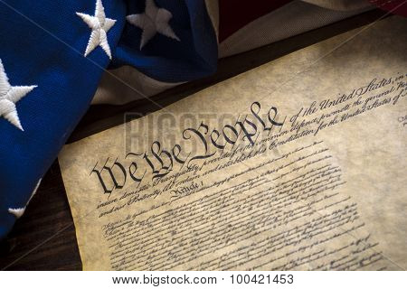 The constitution of the United States of American with a vintage flag
