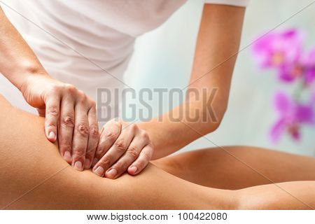 Therapist Applying Pressure With Hands On Upper Thigh.
