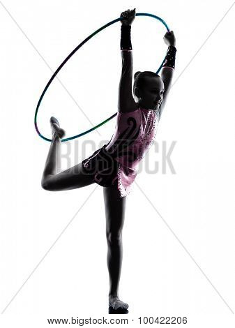 one caucasian little girl child  exercising Rhythmic Gymnastics in silhouette isolated on white background