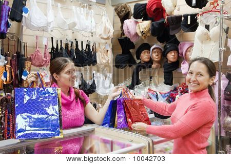 Buyer  And Salesman At  Counter