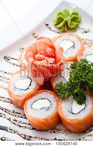 Philadelphia Maki Sushi made of Philadelphia Cream Cheese inside, Fresh Raw Salmon outside. Garnished with Sauce