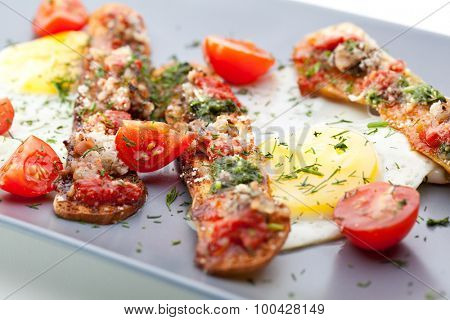 Fried Eggs with Cherry Tomato, Toast with Pesto Sauce and Bacon